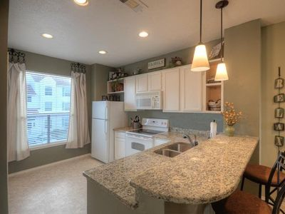 Open & spacious kitchen w/ granite counter tops & brkfst bar!