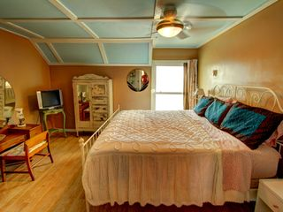 Tybee Island condo photo - King master bedroom with vintage dresser and wardrobe and awesome view of ocean.