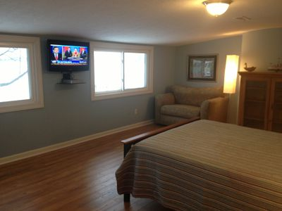 Lake breeze makes sleeping wonderful in master bedroom. new wood floors, hdtv