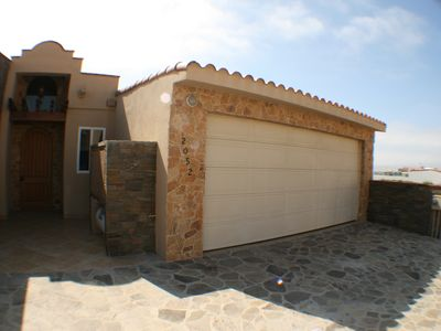 Front and entry to custom 2 story house with Jacuzzi and panoramic ocean views