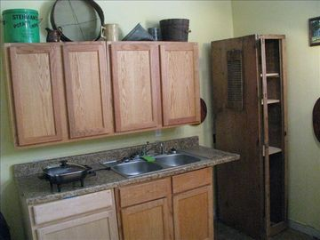 kitchen- microwave,toaster,crock pot,can opener on left on shelves- not shown i