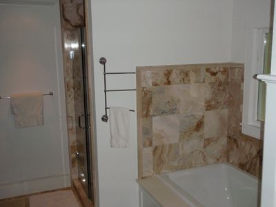 Master Bathroom Shower and Soaking Tub in Onyx
