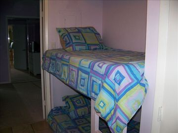Set of bunks built into a nook in the hallway - great for kids!