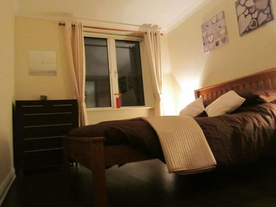Bedroom with King size bed and new dark oak lamina