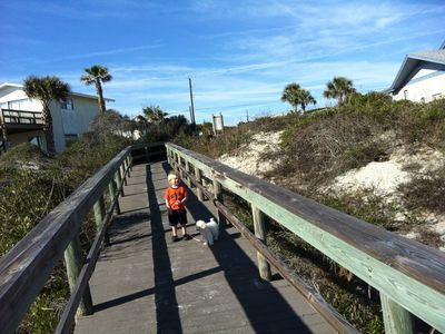 boardwalk over dunes to beach. Notice turtle exiting nest screen middle right.