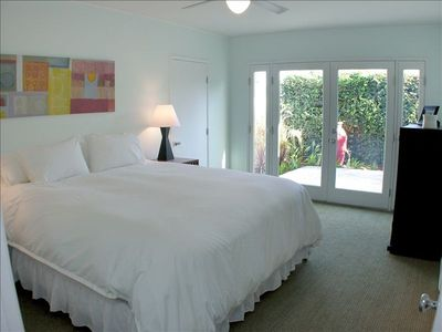 One of two Master Bedrooms, each with New King Size beds and TVs, Own Patios