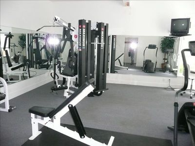 Work Out Room with weights, bike, machines, TV, bathroom