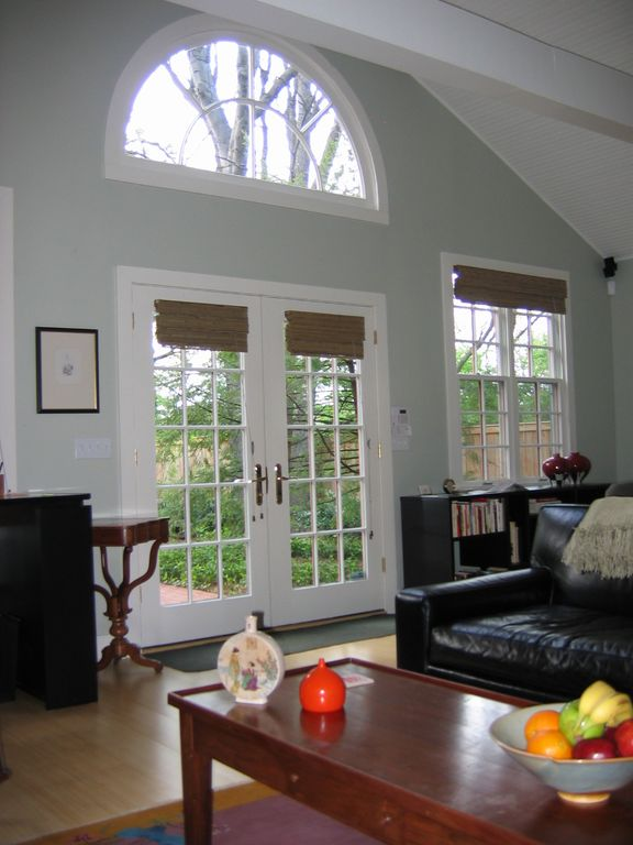 French doors, demi-lune window, and cathedral ceiling bring the outdoors inside.