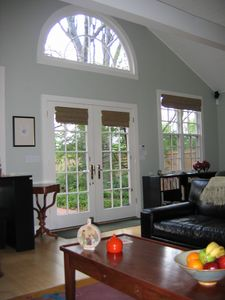 Nashville cottage rental - French doors, demi-lune window, and cathedral ceiling bring the outdoors inside.