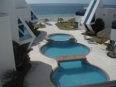 Balcony View overlooking swim pool and beach