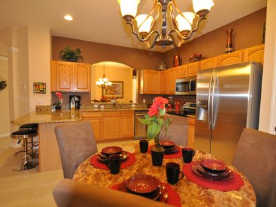 Kitchen Nook DIning area - stainless steel appliances, granite countertop
