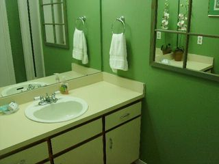 Gulf Shores condo photo - Spacious Master Bathroom - changing area and seperate tub/shower