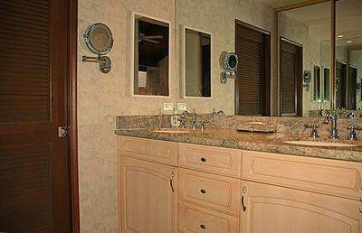 master bathroom with walk-in shower and granite counter top