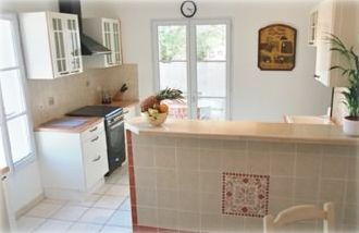 Open plan kitchen; access to utility room, America fridge, laundry facilities.