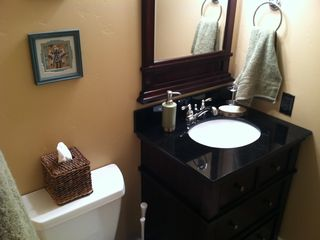 Bathroom with large walk-in shower and heated floors.