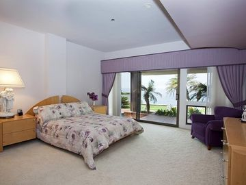 Middle bedroom with patio and ocean view.