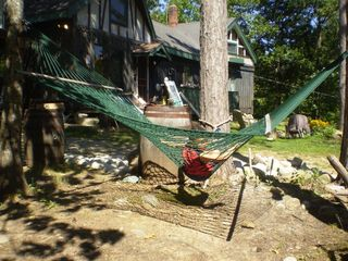 Newfound Lake cabin photo - Hammock next to fire pit. 3 hammocks on the property.