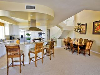 Dining area with seating for 6 and kitchen counter seating for 5. - Carlsbad house vacation rental photo