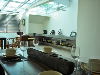 San Juan apartment photo - Living room with kitchen. Have you seen the eye glass on the wall?