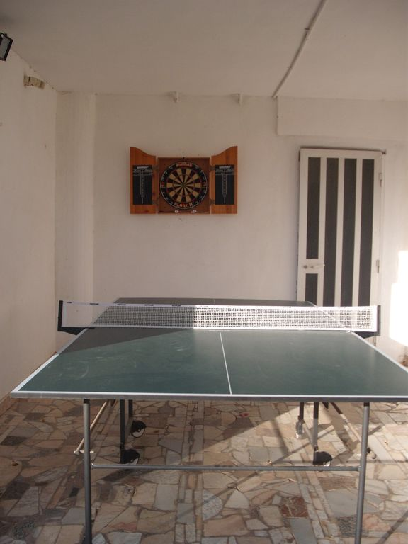 You can play table tennis and darts on the patio