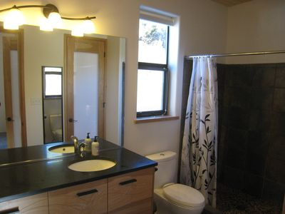 Master Bath with granite top, large tile shower