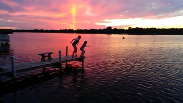 Nekoosa cottage rental - Kids at play during another beautiful Lake Camelot Sunset!