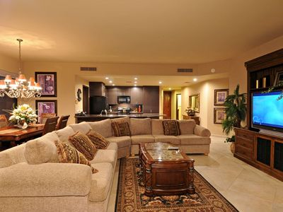 "Great room floorplan, sectional sofa, 52"" LCD TV with surround sound"