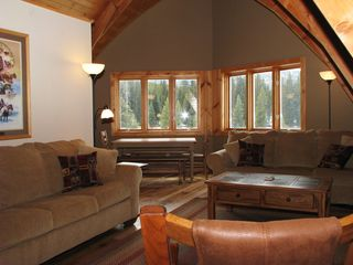 West Yellowstone house photo - Upstairs family room with lots of comfy places to hang out! Two Sofa sleepers.