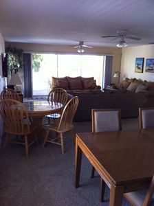 A very large living/dining area with game table