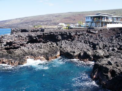 Milolii house rental - The Cove in the forefront with our house sitting on the cliffs above.
