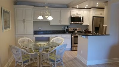 New custom cabinetry and quartz countertops, new stainless steel appliances