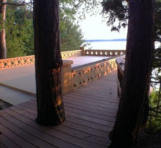 500 sq ft resurfaced deck overlooking lake from stairs leading down to water