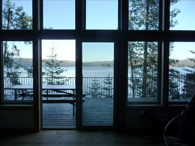 Great room has a 14 ft. vaulted ceiling and lots of glass for lake views