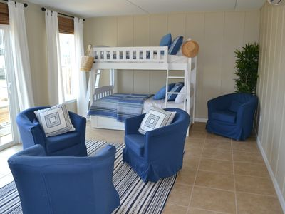 Large and airy bunk room which opens up onto our back deck overlooking the canal