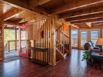 Entry way off deck, living room, deck combo, Open wood beams.