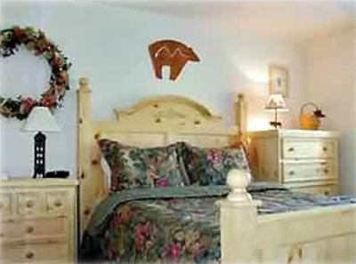 Cozy bedroom and pine furnishings; Red Pine Condo in Park City