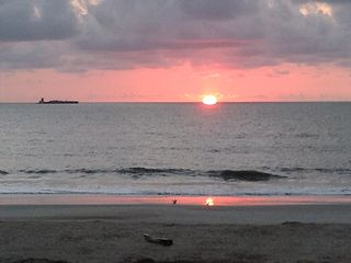 Tybee Island condo photo - Sunrise. View from your deck. Watch ships pass by.