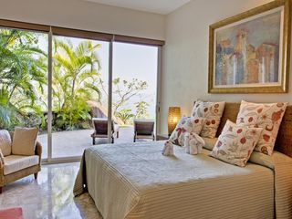 Puerto Vallarta villa photo - Guest bedroom with queen bed leading out to the patio and pool area.