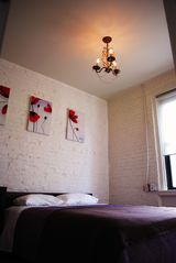Queens apartment photo - Queen size posturepedic mattress, exposed brick wall