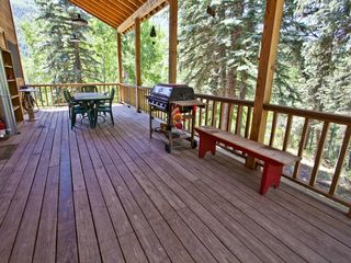 Dolores house photo - West deck has bbq grill and large table. Large hot tub at end seats 6(not shown)