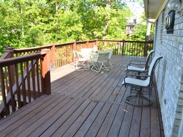 Deck overlooking lake includes table with 4 chairs, along with addt'l chairs