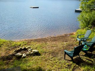 Lake Rescue cottage photo - This is our beach. The raft belongs to the neighbors and not for our use.