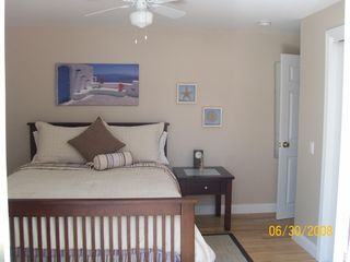 Master Bedroom w/ Deck: All bedrooms are large and new with great closet space! - Provincetown house vacation rental photo