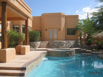 Lake Havasu City house rental - View of pool, raised Jacuzzi, built-in table in pool and patio off Master Suite