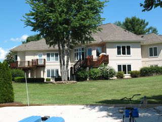 Waterfront view of house from beach area - Lake Anna house vacation rental photo
