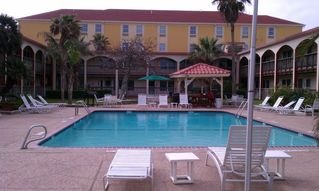 Corpus Christi condo photo - Surfside courtyard with freshwater swimming pool/heated