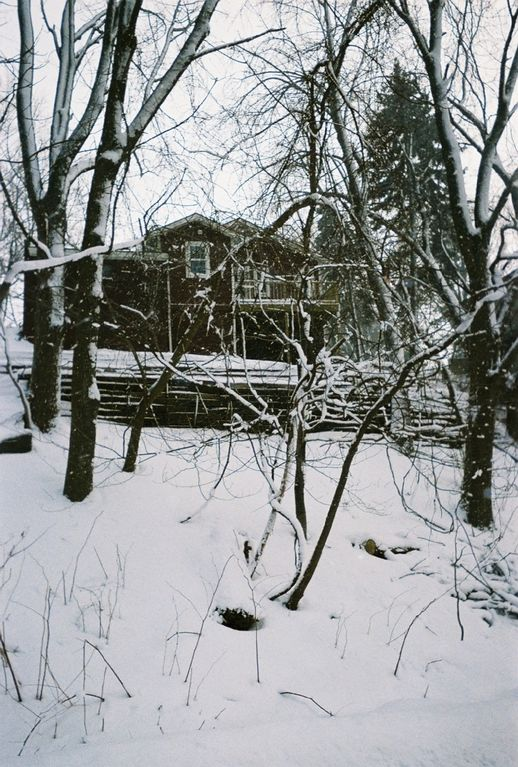 Rear view of cottage in winter
