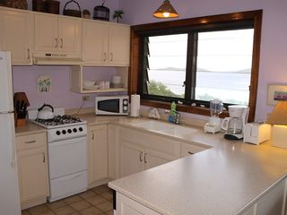 Cruz Bay condo photo - Preparing snacks or meals is a breeze in the fully equipped kitchen.