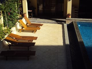 Playa del Coco condo photo - Tanning beds & BBQ area. Agua de Lechuga complex is 3-min. walk from Coco beach