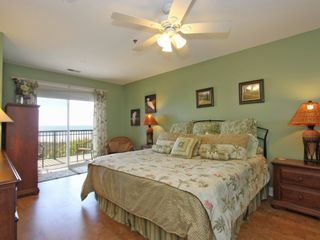 Isle of Palms condo photo - King bed-master suite with sliders to deck overlooking the ocean